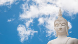 Old buddha statue on Clouds and blue sky background.