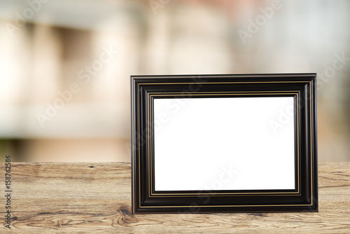 picture frame photo retro pace on wood table.