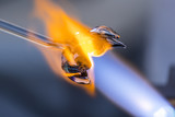 close up of glass blowing with a torch  - 158767312