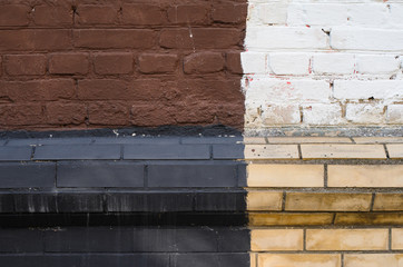 Multicolored old brick wall background. Black, white, brown and yellow mosonry texture
