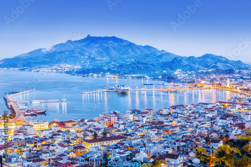 Zante - Zakinthos islnad, capital city, view from above, twilight scenery, panoramic aspect ratio photography. Zante is famous and popular summer resort. Greece, EU country.