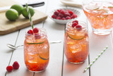 Two Raspberry Lime Iced Teas in Mason Jars with Ingredients