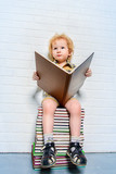 small boy with a book
