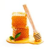 Honeycomb with honey dipper isolated on white background
