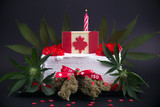 Cake with cannabis nugs flowers and flag to celebrate candian 150 anniversary