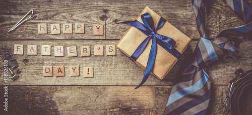 Father's day concept - present, tie on rustic wood background - 158825183
