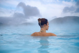 Woman enjoys spa in geothermal hot spring