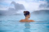 Woman enjoys spa in geothermal hot spring - 158829526