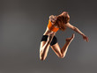 Beautiful modern ballet dancer jumps and dance on  isolated background