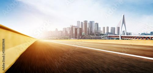 Motorway and modern city skyscrapers