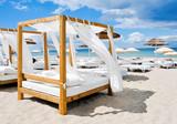 Fototapeta beds in a beach club in Ibiza, Spain