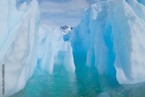 In de dag Antarctica Blue shimmering beautiful iceberg in Antarctica
