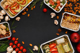 Fototapeta Healthy food take away in boxes, background on black