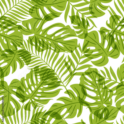 Vector seamless pattern with green palm tree leaves. Summer tropical background. Trendy design for fabric and textile print.