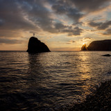 Seashore at sunset. Rock of the holy phenomenon.