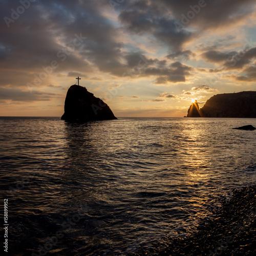 Plagát Seashore at sunset. Rock of the holy phenomenon.