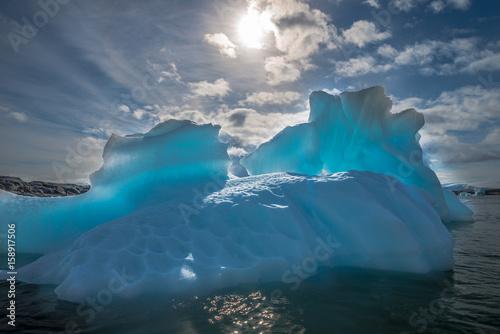 Azure shimmering translucent iceberg in Antarctica