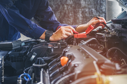 Hands of car mechanic  working in auto repair service. - 158966148