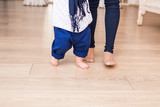 Baby feet doing the first steps. Baby's first steps. Child feet . - 158973360