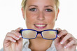 woman holding a pair of glasses - 158973718