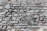 Old grungy gray stone wall texture