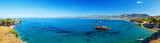 Panorama of beautiful scenery - traditional old fashioned cruise boat docked to the sand shore and colorful blue azure crystal clear water of Aegean Sea, Crete, Greece - 158985195