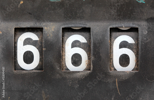 Poster number 666 on old rusty counter of fuel pump