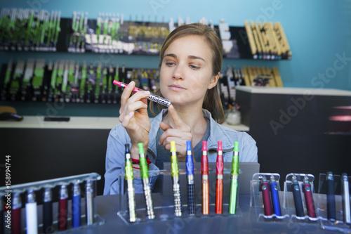 In a shop selling e-cigarettes, Paris, France