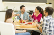 Young people have a meal in the dining room in modern home - 159017570