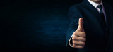 Businessman showing a thumbs up sign. - 159042767