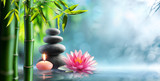 Fototapeta Bamboo - Spa - Natural Alternative Therapy With Massage Stones And Waterlily In Water