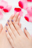 Woman presenting her beautiful painted gel hybrid nails
