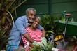 Portrait of happy senior couple embracing in backyard