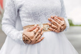 Close-up of hands decorated with a picture of a mehendi of a Muslim bride at a wedding ceremony nikah