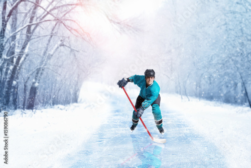 Ice hockey player in uniform on frozen walkway