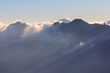 Cloud and mist in mountain sunset panorama view, at Mountain Rinjani, active volcano at Lombok island of Indonesia