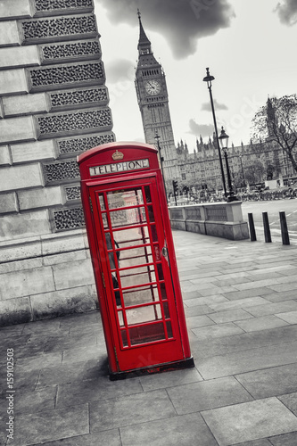 Red Telephone Booth and Big Ben in London street, uk