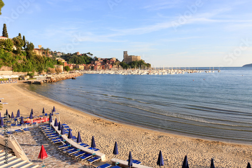 The shore of the marine village of Lerici in Italy, on the background its mediev Poster