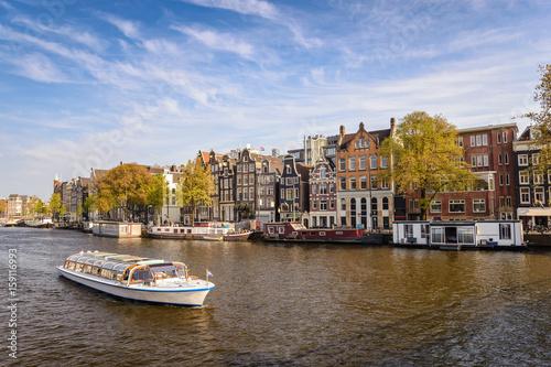 Foto op Plexiglas Amsterdam Amsterdam city skyline at canal waterfront, Amsterdam, Netherlands