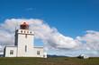 Lighthouse over Black sand beach - island
