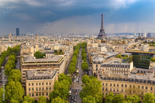Paris city skyline view from Arc de Triomphe with Eiffel Tower, Paris, France Photo by Noppasinw