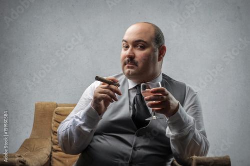 Rich man smoking a cigar Poster
