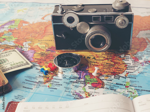 Accessories for travel, on world map.