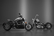 Old and New motorbikes on dark background