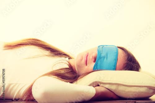 Brunette woman sleeping in blue eye sleep mask Poster
