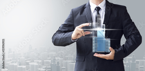 Fototapeta business man create design modern building