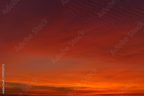 Beautiful colorful winter sunset sky. Unusual weather phenomenon. Background