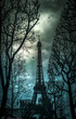 The Eifel tower in clouds at daytime.