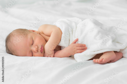 Newborn baby sleeping on a blanket. Age 1 week Poster