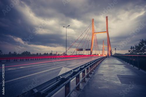 Car light trails on modern bridge during storm - Warsaw, Siekierkowski bridge
